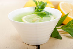 Mint infusion tea tisane with lemon. Fresh and healthy mint infusion tea tisane with lemon Stock Photos