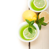 Mint infusion tea tisane with lemon. Fresh and healthy mint infusion tea tisane with lemon Royalty Free Stock Images