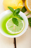 Mint infusion tea tisane with lemon Royalty Free Stock Photo