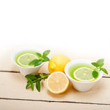 Mint infusion tea tisane with lemon Stock Photo