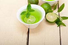 Mint infusion tea tisane with lime. Fresh and healthy mint infusion tea tisane with lime Stock Photography