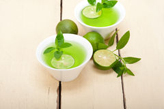 Mint infusion tea tisane with lime. Fresh and healthy mint infusion tea tisane with lime Royalty Free Stock Image