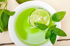 Mint infusion tea tisane with lime. Fresh and healthy mint infusion tea tisane with lime Royalty Free Stock Photo
