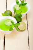 Mint infusion tea tisane with lime. Fresh and healthy mint infusion tea tisane with lime Stock Image