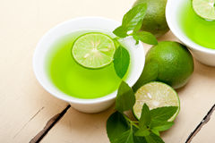 Mint infusion tea tisane with lime Royalty Free Stock Photography