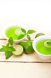 Mint infusion tea tisane with lime. Fresh and healthy mint infusion tea tisane with lime Stock Photos