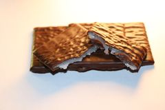Milk chocolate patties with a mint filling inside it. Mint inside the chocolate squares. popular around christmas time, but delicious anytime of the year Stock Photo