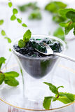 Mint jelly. In glass with spoon and fresh mint leaves Royalty Free Stock Photo