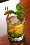 Mint julep. Close up of a mint julep served on the rocks and garnished with fresh green mint on top, kentucky derby drink Royalty Free Stock Photography