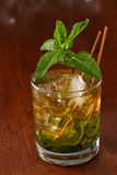Mint julep. Close up of a mint julep served on the rocks and garnished with fresh green mint on top, kentucky derby drink Stock Photos