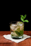 Mint Julep Cocktail. Mint julep  on a black background served on a bar top garnished with fresh mint Royalty Free Stock Image