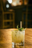 Mint julep cocktail drink in bar Stock Photography