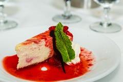 Mint Leaf Garnish on Strawberry Cheesecake Royalty Free Stock Image