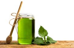 Mint leaf green honey in a jar isolated. On white royalty free stock photo