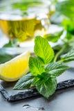 Mint leaf. Mint leaves. Tea. Mint Tea. Herbal tea. Tea in a glass cup, mint leaves, dried tea, sliced lime. herbs tea and mint Stock Images