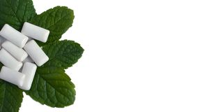 Mint leaves and chewing gum on white background royalty free stock photo