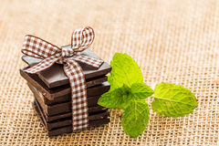 Mint leaves and chocolate underneath burlap. Stock Image
