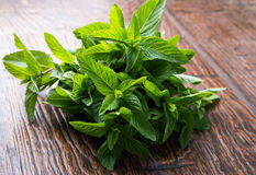 Mint leaves on the table Stock Photo