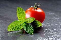 Mint leaves and tomato Royalty Free Stock Image