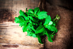 Mint leaves on wooden table closeup. Bunch of Fresh green organi Stock Photo