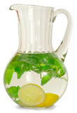Mint and lemon. A drink of lemon and mint in glass jug isolated on white background Royalty Free Stock Image