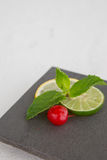 Mint and lemon slices garnish Stock Photography