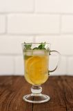 Mint lemonade in Irish mug. On white brick background Stock Images