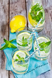 Mint lemonade. Mint lemonad in glasses and pitcher. Selective focus Stock Photo
