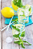 Mint lemonade. Mint lemonad in glasses and pitcher. Selective focus Royalty Free Stock Image