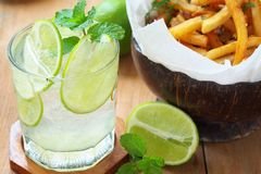 Mint and lime refreshing. And french fries royalty free stock photos