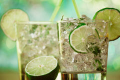 Mint and lime refreshing summer cocktails Stock Photos