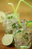 Mint and lime refreshing summer cocktails Stock Images