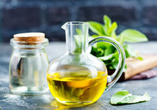 Mint oil. In bottle and on a table Stock Images