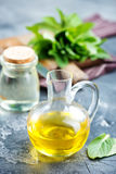 Mint oil. In bottle and on a table Stock Photo