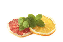Mint on orange and blood grape Royalty Free Stock Photos