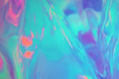 Mint pastel colored holographic background. Abstract trendy holographic background in 80s style. Blurred texture in violet, pink and mint colors with scratches stock image