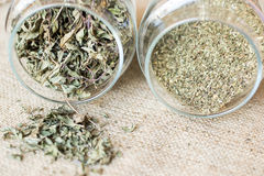 Mint and peppermint. Dried mint and peppermint in jars on textile background stock photo