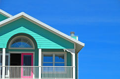 Mint and Pink coastal Home. Bright beachfront home with mint siding and pink doors Stock Photos