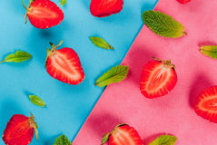 Mint and strawberry on colorful background Royalty Free Stock Photography