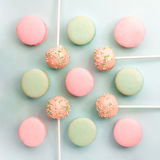 Mint and strawberry flavor macarons and cake pops on sticks. Flat lay. Top view Royalty Free Stock Photos