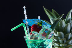 Mint, strawberry and pineapple cocktail over black Royalty Free Stock Image