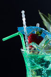 Mint, strawberry and pineapple cocktail over black Royalty Free Stock Photography