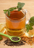Mint tea. Detail of a cup of mint tea with honey and lemon Royalty Free Stock Photo