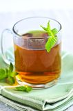 Mint tea. Cup of fresh herbal mint tea with peppermint leaves stock photo