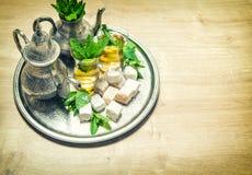 Mint tea with arabic delight. Oriental hospitality. Vintage styl Stock Photos