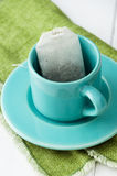 Mint tea bag in blue cup Royalty Free Stock Photography