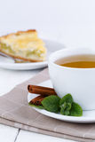 Mint tea with cinnamon on wooden table. Stock Images