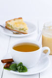Mint tea with cinnamon on wooden table. Stock Image