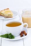 Mint tea with cinnamon on wooden table. Royalty Free Stock Image