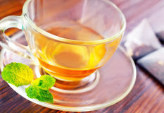Mint tea. In cup and on a table royalty free stock images